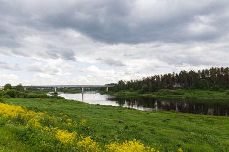Beautiful summer day by the river, thunderclouds, Kraslava, Latgale, Latvia Zdjęcie Seryjne - 153195260