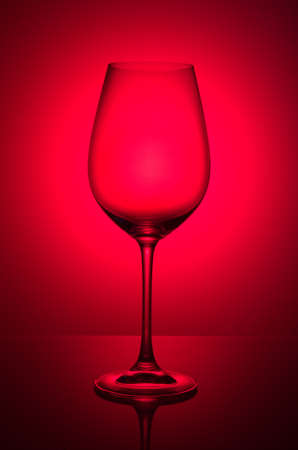 Wine glass on red color background, studio shooting, 写真素材
