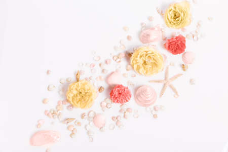 Composition of flowers, frame from rose flowers and seashells, starfish on a white background. Flat lay, top view, 写真素材