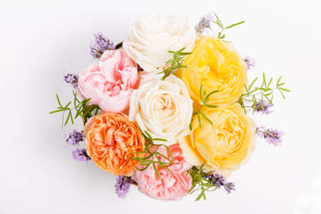 Beautiful bouquet with pink, yellow and coral roses on white background. 写真素材