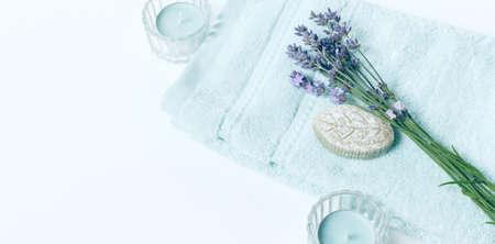 Spa background in pastel blue color, flat lay, towel, soap, lavander flowers 写真素材 - 165890492