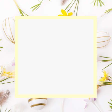Easter floral background, easter eggs end spring flowers crocus decorated with natural botanical elements, flat lay, blank space for greeting text