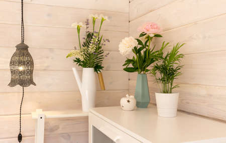 Festive romantic bouquets of white and pink peonies on a white wooden wall background, Scandinavian style. Wedding background 免版税图像