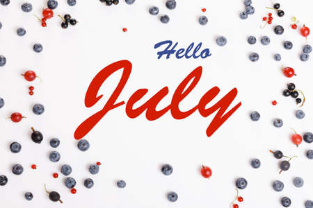 Red and blue berries of currants, gooseberries and blueberries, on a white background flat lay. Hello July wallpaper, summer table background. Banner