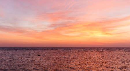 Fiery orange sunset sky. Beautiful sky. Baltic sea and beautiful sky with clouds before sunrise