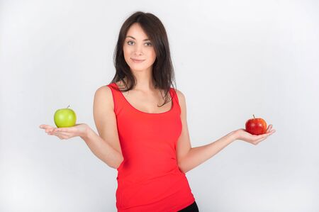 red tshirt: Business beautiful brunette woman in red T-shirt with apples Stock Photo
