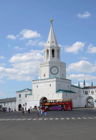 sightseers: KAZAN, RUSSIA - JULY 21, 2013  sightseers near the Spassky Tower of the Kazan Kremlin