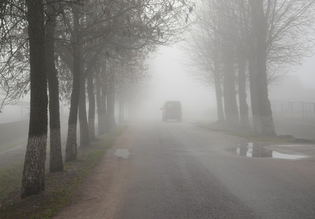 Thick shroud of fog in late autumn in a small town photo