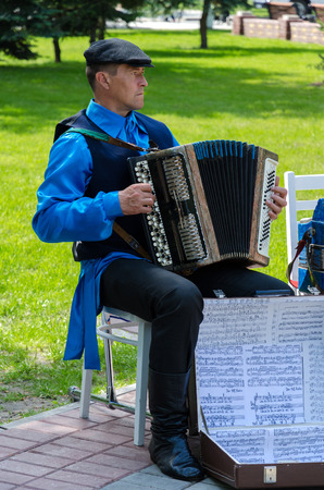 harmonist: GOMEL, BELARUS - MAY 16: Rural harmonist at the event City Wizards in May 16, 2014 in Gomel, Belarus Editorial