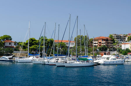 sithonia: NEOS MARMARAS, GREECE - AUGUST 16 2014: Yacht at berth in August 16 in Neos Marmaras, Sithonia, Greece