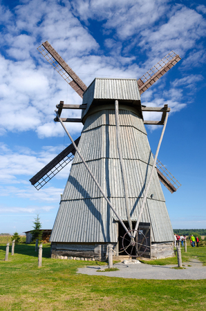 sightseers: DUDUTKI, BELARUS - SEPTEMBER 6 2014: Unknown sightseers are visiting the windmill in museum of ancient national crafts and technologies in Dudutki, Minsk region, Belarus in September 6 2014
