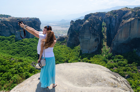 meteors: METEORS, GREECE - AUGUST 11, 2014: Tourists take pictures themselves on a background  of a beautiful view in August 11, 2014 in Meteors, Greece