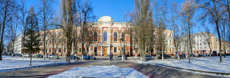 previously: GOMEL, BELARUS - FEBRUARY 16, 2015: Unidentified people walk down street to Belorussian State University of Transport (previously - Mens classical gymnasium, 1898, architect S.Shabunevsky) Editorial