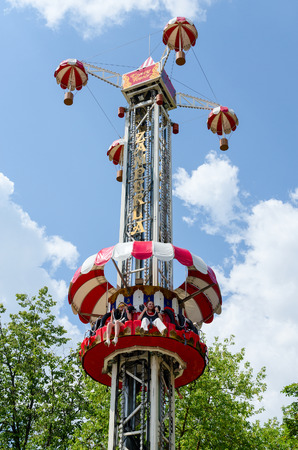 adrenaline: GOMEL, BELARUS - JULY 8, 2014: Unidentified girls are on an attraction Adrenaline in the park Lunacharsky in Gomel, Belarus