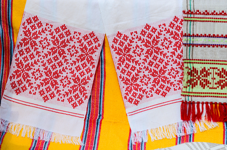 bedcover: Belorussian towels with traditional ornaments on the background a bright colored rustic bedcover