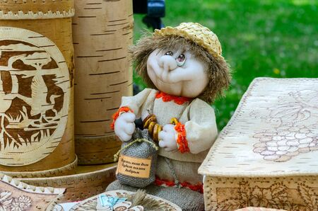 birchbark: GOMEL, BELARUS - MAY 22, 2015: Outdoor event City of Masters. Exhibition and sale of products from birch bark and toys souvenirs Editorial