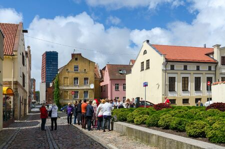 sightseers: KLAIPEDA, LITHUANIA - JULY 11, 2015: Unidentified tourists see the sights in the street of the Old Town in Klaipeda