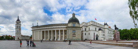 casimir: VILNIUS, LITHUANIA - JULY 10, 2015: Unidentified tourists walk on Cathedral Square near Cathedral of St. Stanislaus and St. Vladislav, bell tower, cappella of St. Casimir, Palace of Grand Dukes of Lithuania Editorial