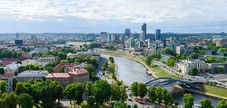 right bank: VILNIUS, LITHUANIA - JULY 10, 2015: Panoramic view of the river Neris and high-rise buildings of the City on the right bank