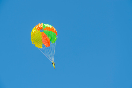 is cloudless: ZYABROVKA, BELARUS - AUGUST 8, 2015: Unknown parachutist performs a jump on the background of a cloudless blue sky Editorial