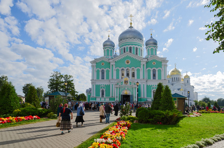 seraphim: DIVEEVO, RUSSIA - AUGUST 22, 2015: Unknown pilgrims go to the Trinity Cathedral and the Transfiguration Cathedral in Holy Trinity Seraphim-Diveevo convent in the village Diveevo