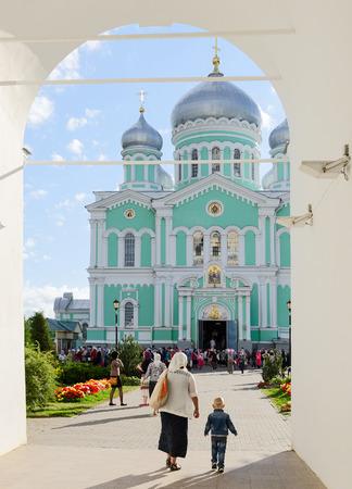 seraphim: DIVEEVO, RUSSIA - AUGUST 22, 2015: Unknown pilgrims go to morning Divine Liturgy at Trinity Cathedral of Holy Trinity Seraphim-Diveevo nunnery in village Diveevo, Nizhny Novgorod region, Russia