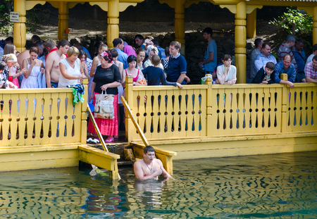 baptized: TSYGANOVKA, RUSSIA - AUGUST 22, 2015: Unknown pilgrims are on the holy spring of St. Seraphim of Sarov near the village Tsyganovka, Russia