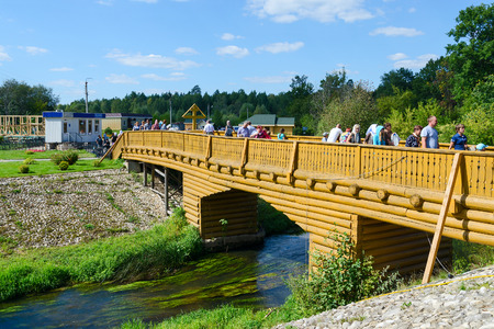 seraphim: TSYGANOVKA, RUSSIA - AUGUST 22, 2015: Unknown pilgrims go on the bridge over the river Satis on holy source in the name of St. Seraphim of Sarov near the village Tsyganovka in Nizhny Novgorod Region, Russia Editorial