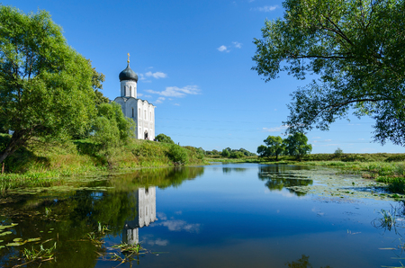 nerl river: BOGOLUBOVO, RUSSIA - AUGUST 21, 2015: Church of the Intercession on the Nerl near the village Bogolubovo, Vladimir region, Russia Editorial