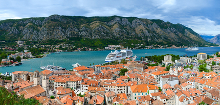balkan peninsula: KOTOR, MONTENEGRO - SEPTEMBER 21, 2015: Top view of the Old town and cruise ship in the Bay of Kotor, Montenegro Editorial