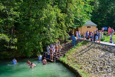 seraphim: TSYGANOVKA, RUSSIA - AUGUST 22, 2015: Unknown pilgrims are dipping in water on the holy source in the name of St. Seraphim of Sarov near the village Tsyganovka, Russia