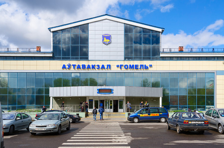 bus station: GOMEL, BELARUS - APRIL 23, 2016: Unidentified people go to the building of bus station Gomel, Belarus