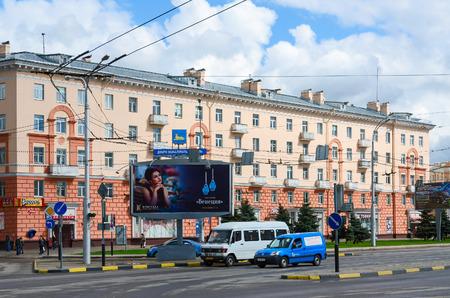 display advertising: GOMEL, BELARUS - APRIL 23, 2016: Unidentified people walk down the street near shopping center Start, Gomel, Belarus