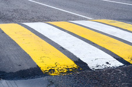 unevenness: Lying policeman with marking of pedestrian crossing on the road in city Stock Photo