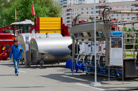 industry: GOMEL, BELARUS - MAY 19, 2016: Unidentified man inspects equipment for food industry and agriculture in open air during XVII International Universal Exhibition-Fair Spring in Gomel-2016 Editorial