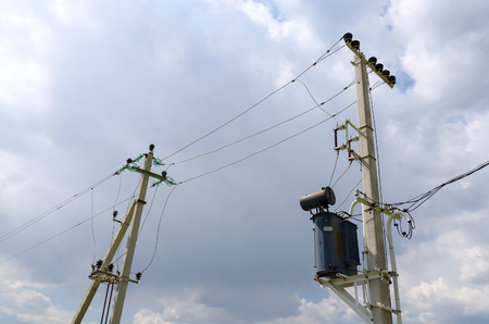 earthing: Supporting pillars of power line in countryside