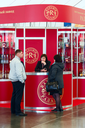 acquirer: GOMEL, BELARUS - MAY 19, 2016: Unidentified people are talking near the demonstration stand of JSC Gomel Distillery Radamir at XVII International exhibition Spring in Gomel, Belarus