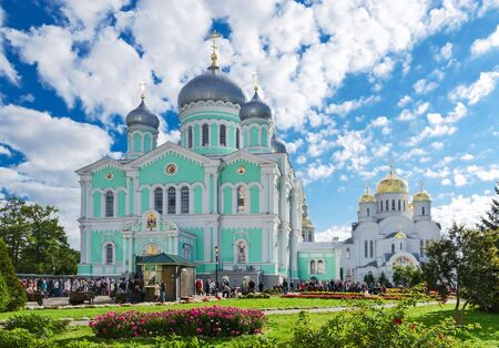 liturgy: DIVEEVO, RUSSIA - AUGUST 22, 2015: Unidentified pilgrims go to Divine Liturgy at Trinity Cathedral and Saviour Transfiguration Cathedral of Holy Trinity Seraphim-Diveevo convent in village of Diveevo, Russia