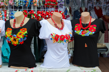 blouses: VITEBSK, BELARUS - JULY 13, 2016: Street trade on Slavonic Bazaar Festival in Vitebsk. Clothing with embroidery satin stitch Editorial