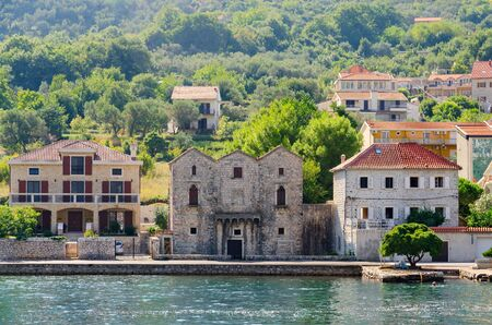 three sisters: PRCANJ, MONTENEGRO - SEPTEMBER 16, 2015: House Three Sisters (Tre Sorelle) in Prcanj, Kotor Bay, Montenegro. Monument of architecture of XV century Editorial