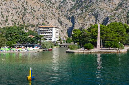 KOTOR, MONTENEGRO - SEPTEMBER 16, 2015: Obelisk of Freedom in Freedom Park on waterfront in Kotor, Montenegro