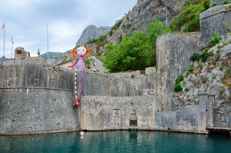 impregnable: KOTOR, MONTENEGRO - SEPTEMBER 21, 2015: Doll on fortress wall of bastion Gurdich (1470), Old Town of Kotor, Montenegro Editorial