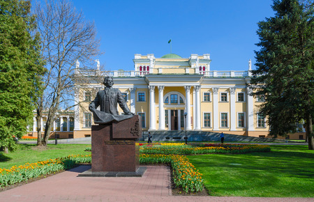 petrovich: GOMEL, BELARUS - APRIL 29, 2016: Palace of Rumyantsev-Paskevich and monument to Count Rumyantsev in spring park, Gomel, Belarus Editorial