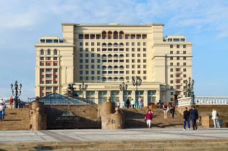 prestigious: MOSCOW, RUSSIA - JULY 23, 2016: Unidentified people walk on Manezhnaya Square near famous prestigious building of Four Seasons Hotel Moscow 5 * (previously -  hotel Moscow) Editorial