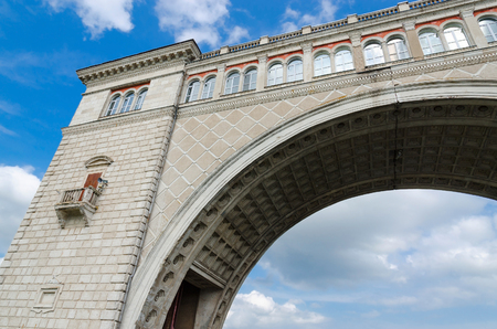 navigable: Fragment of arch of navigable sluice of Uglich hydroelectric power against blue sky, Russia