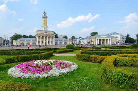 kostroma: KOSTROMA, RUSSIA - JULY 20, 2016: Buildings fire tower and former guardhouse on Susaninskaya square, Kostroma, Golden Ring of Russia. Unidentified people are on square, which is favorite place for recreation and meetings in city