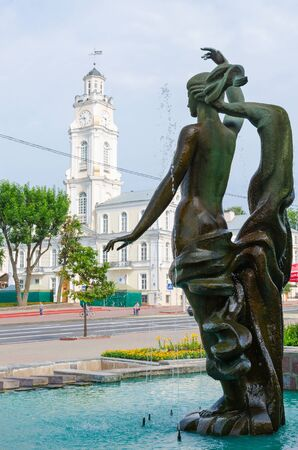 VITEBSK, BELARUS - JULY 13, 2016: Fragment of fountain Merger of three rivers on background of town hall, Vitebsk, Belarus