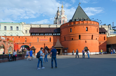 spassky: MOSCOW, RUSSIA - JULY 23, 2016: Unidentified people walk on Theater Square near famous prestigious restaurant Old Tower which is located in ancient tower China- city wall. In background - Savior Cathedral of Zaikonospassky monastery Editorial