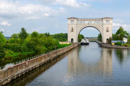 navigable: UGLICH, RUSSIA - JULY 19, 2016: Dry cargo ship Ochakov in navigation lock of Uglich hydroelectric power station, Russia