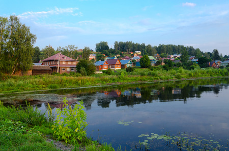 Quiet provincial town of Ples on shore of pond in summer twilight, Russia Stock Photo